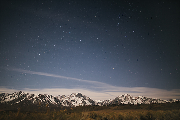Dramatic Night Sky, Complete with Stars and a Snow-Capped Mountain Range on a Hot Springs Camping Trip near Mammoth, California // WeAreAdventure.us