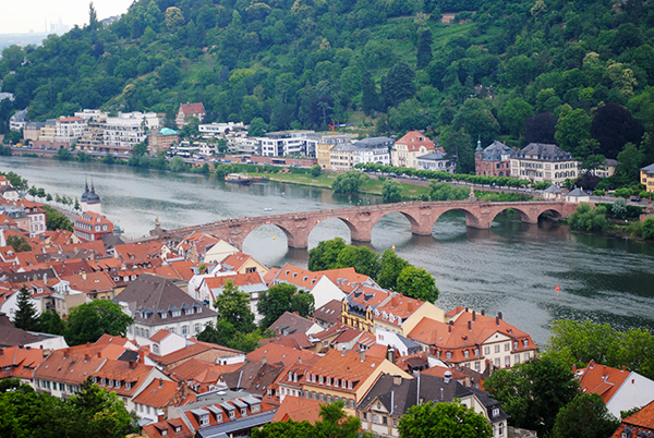 The Alte Brücke (Old Bridge) over the Neckar River in Heidelberg, Germany // WeAreAdventure.us