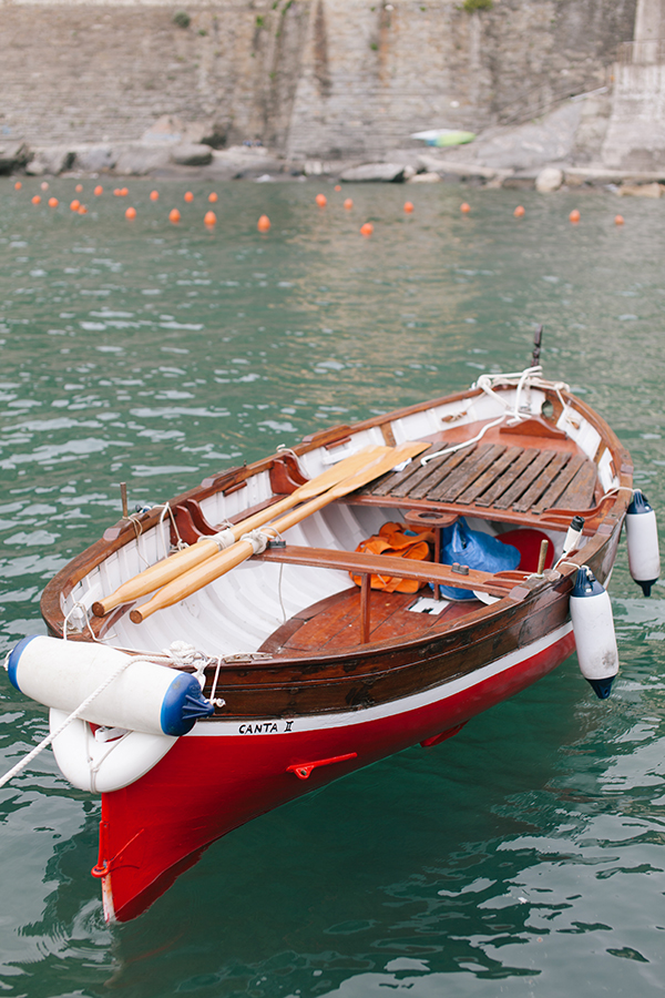 A Pretty Red Boat in the Harbor, Cinque Terre, Italy  // WeAreAdventure.us